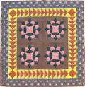Pieced calico crib quilt