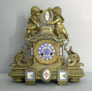 French gilt bronze mantle clock with hand painted porcelain mounts