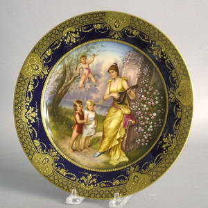 Painted porcelain plate with a maiden and 3 children