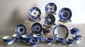 Group of flow blue cups and saucers