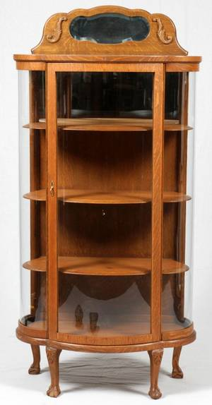 AMERICAN CARVED OAK CURIO CABINET