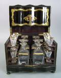 English ebonized cased liquor set 19th c