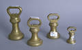 Four brass wool weights by Parnall  Sons