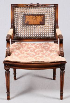 LOUIS XVI STYLE CARVED WALNUT  CANE ARMCHAIR