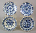 Four English blue and white delft plates mid 18th c