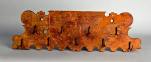 Carved and painted utensil rack