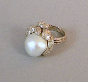 14K white gold pearl and diamond ring with center 13 mm baroque pearl surrounded by floral decoration encrusted with diamonds