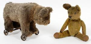 ANTIQUE TOY BEAR ON WHEELS AND SMALL TEDDY BEAR