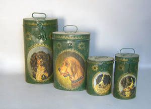 Set of four painted tins with dog portraits