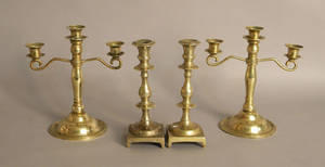 Two pair of brass candlesticks