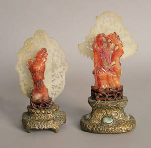 Pair of Chinese carved hard stone boudoir lamps with jade backdrops