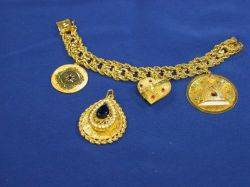 14kt Gold Charm Bracelet and a 14kt Gold and Blue Stone Pendant