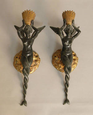 Pair of figural metal sconces in the form of winged mermaids