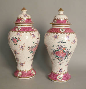 Large pair of Sampson type porcelain urns and covers