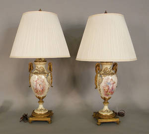 Pair of painted porcelain table lamps with ormolu mounts