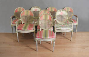 Set of eight French caned dining chairs