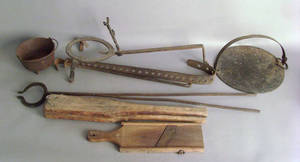 Group of iron and wood kitchen implements