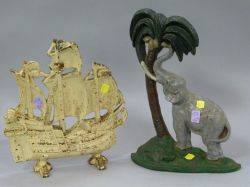 Painted Cast Iron Elephant and Coconut Tree Doorstop and a Painted Cast Iron Sailing Ship Doorstop