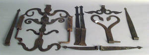 Group of wrought iron hardware to include five rams horn hinges