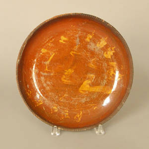 Pennsylvania slip decorated redware plate