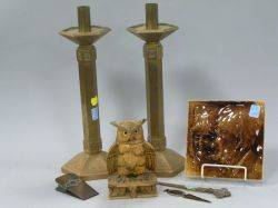 Low Portrait Plaque a Pair of Bronze Candlesticks Carved Wood Owl Inkwell and Three Desk Items