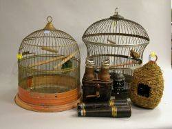 Two Painted Tin Birdcages a Moss and Wicker Bird House and Two Pairs of Binoculars