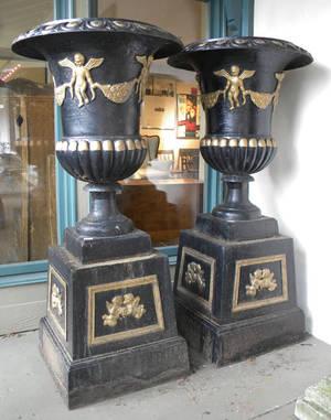 Pair of massive cast iron garden urns