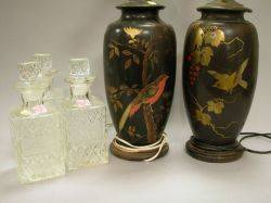 Pair of Asianstyle Gilt Bird and Branch Decorated Black Ceramic Table Lamps and a Set of Three Pressed Colorless Glass Decanters