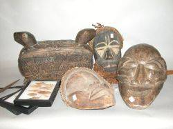 Two African Spears Carved Wood Box Three Carved Wood Masks and Three Frames of Points