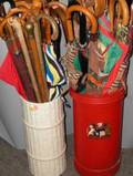 Collection of Approximately Thirtyseven Umbrellas and Walking Sticks in Two Stands