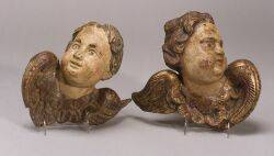 Pair of Carved and Painted Wood Cherub Wall Plaques