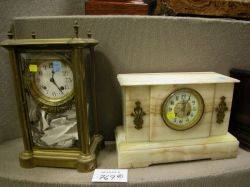A Stowell Co Late Victorian Onyx Mantel Clock and an Ansonia Frenchstyle Brass and Glass Mantel Clock