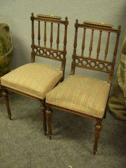 Pair of French Neoclassical Carved Walnut and Upholstered Side Chairs
