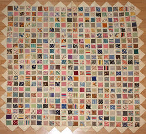 Unusual Pennsylvania appliqu quilt with floating calico squares on a pieced linen background