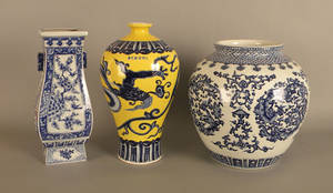 Chinese blue and white porcelain vase together with a yellow vase with dragon and a blue and white jardinire