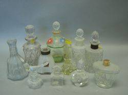 Collection of Twentyfour Colorless Glass Perfume Bottles