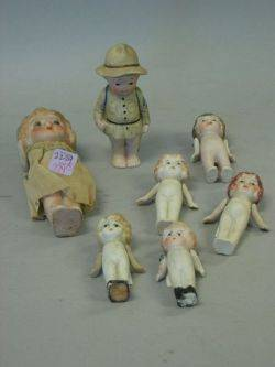 Seven Small Japanese Bisque Dolls and Figures