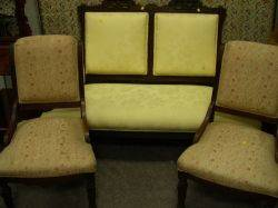 Eastlaketype Upholstered Carved Walnut Settee and a Pair of Renaissance Revival Upholstered Carved Walnut Parlor Side Chairs