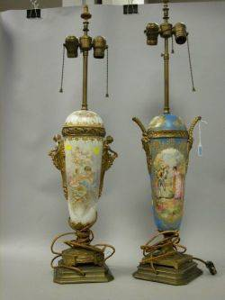 Two Giltmetal Mounted Sevresstyle Gilt and Scenic Decorated Porcelain Table Lamps