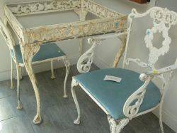 White Painted Cast Metal Patio Table and Set of Four Side Chairs