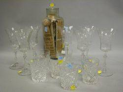 Six Colorless Cut Glass Tumblers Set of Seven Colorless Etched Glass Goblets and a Glass Apothecary Jar