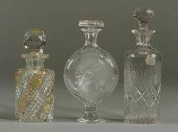 Collection of Eight Colorless Glass Cologne Bottles