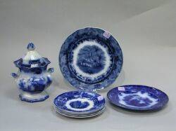 Six Flow Blue Ceramic Plates and a Covered Sugar Urn