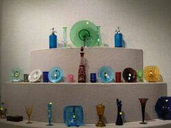 Twentyeight Colored Glass Plates Vases Tumblers Etc