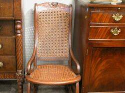 Victorian Upholstered Carved Walnut Folding Chair and an Upholstered Walnut Rocker