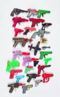 Group of twenty eight toy guns
