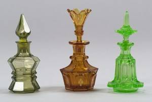 Three Molded Colored Glass Colognes