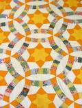 Double Wedding Ring and Star Pattern Pieced Cotton Quilt