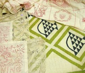 Pieced Cotton Quilt and a Figural Embroidered Cotton Coverlet with a Pair of Pillow Covers