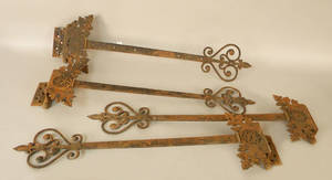 Four large iron door hinges